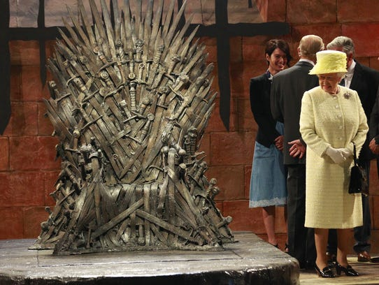 Britain's Queen Elizabeth visits the throne room at the set of the Game of Thrones TV series in  Titanic Quarter, in Belfast Northern Ireland, Tuesday, June, 24, 2014. The Queen is on a 3 day visit to Northern Ireland.  (AP Photo/Peter Morrison)