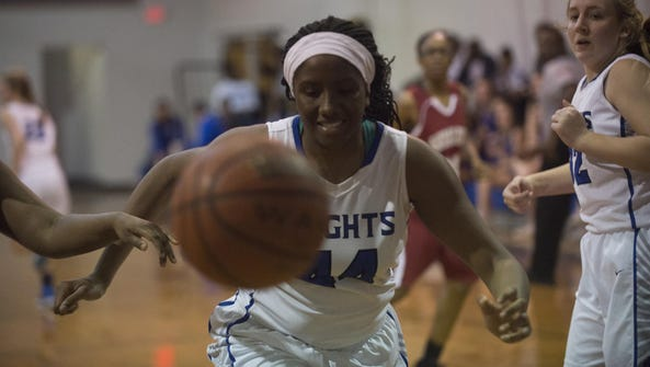 Iyana Tate, who set a Catholic record with a 27-rebound