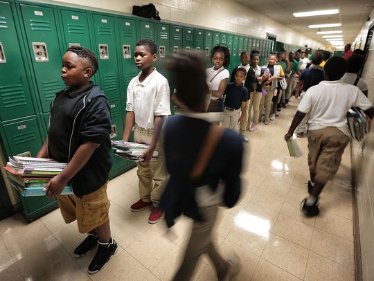 Sixth graders at Grandview Heights Middle wait in line