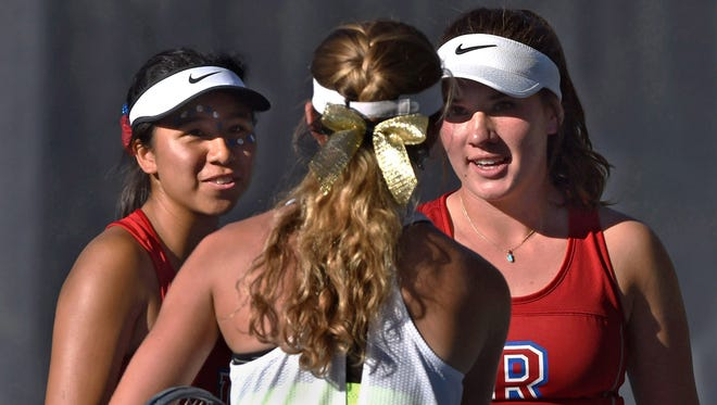 Reno high's tennis doubles partners Jazlyn Parker, left, and Jill Rovetti, right, shake hands at the Caughlin Ranch Athletic Club on Oct. 6, 2017.