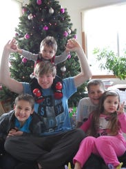 Deven Guilford with his niece and nephews.
