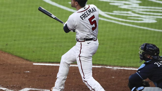 072920 Atlanta: Atlanta Braves Freddie Freeman hits a 2-run homer to score Ronald Acuna to take a 2-0 lead over the Tampa Bay Rays during the third inning on Wednesday, July 29, 2020 in Atlanta.