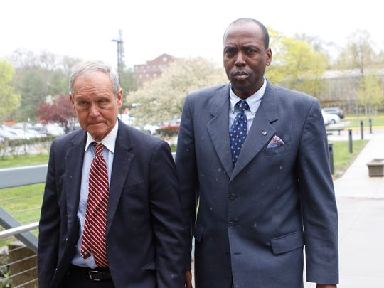 Spring Valley Trustee Vilair Fonvil, right, arrives at the Rockland County Courthouse in New City with attorney Kenneth Gribetz, on Tuesday, April 25, 2017.
