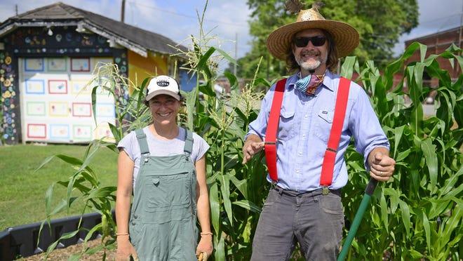 Jonathan and Becca Gardner stand in the Windy Van Hooten Teaching Garden on 12th Street in Gadsden.