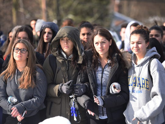 Senior students (L to R), Maxx Wexler, Alexa Belnick, Rebecca Volkov and Amy Depol listen to a speaker after students of Pascack Hills High School in Montvale, walked out in support of stricter gun control laws, photographed on 03/14/18.