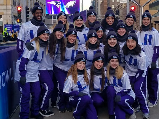 A group of dancers poses in Minneapolis Friday, Jan.