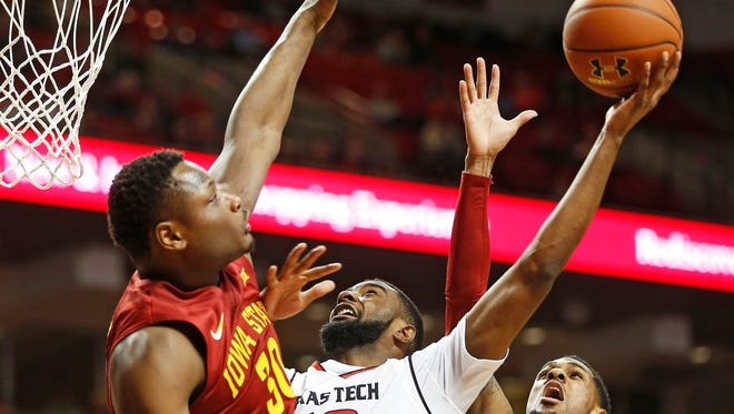 Texas Tech's Niem Stevenson (10) tries to shoot the ball over Iowa State's Deonte Burton (30) and Monte Morris (11) during Monday's game.(Brad Tollefson/Lubbock Avalanche-Journal via AP)