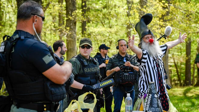 Vermin Supreme, right goes through the security checkpoint with everyone else as they gather to protest the annual American Renaissance conference at the Montgomery Bell State Park in Burns, Tenn., Saturday, April 28, 2018.