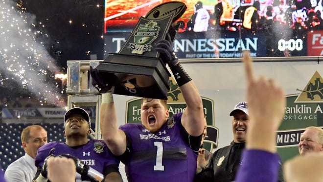 Defensive lineman Tyler Lancaster (1) and Northwestern celebrate after beating Kentucky to win the 2017 Music City Bowl in Nashville. Northwestern prevailed 24-23 for its first consecutive bowl victories in school history.