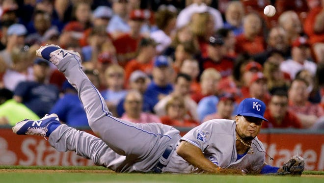 Kansas City Royals third baseman Cheslor Cuthbert dives but is unable to catch a single hit by St. Louis Cardinals' Jhonny Peralta during the fifth inning of a baseball game Wednesday, June 29, 2016, in St. Louis.