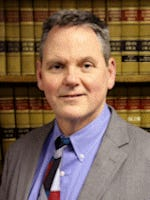 H. Brian Maynard, Kentucky's new insurance commissioner, declined to defend the consumer protection law.