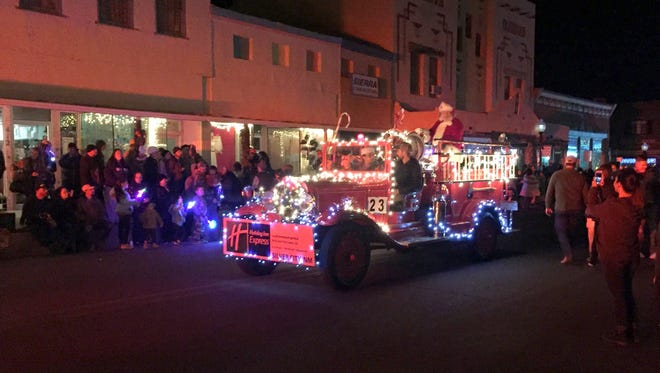 An annual tradition is the Lighted Christmas Parade in downtown Silver City. It occurs the first Saturday after Thanksgiving which starts the holiday shopping season. Above, Santa Claus makes his way up Bullard Street during this year's Lighted Parade.