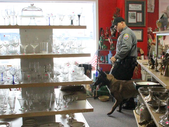 Alamogordo Police Department officer William Lewandowski and K-9 officer Zeus conduct a search demonstration inside the Twice Blessed Thrift Store Sunday.