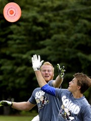 Jonathan Luedke (left) and Tanner Beckman go after the disc as the Appleton Assassins take part in the Wisconsin Guts Frisbee Championship earlier this month at O'Hauser Park in Neenah. The team heads to London later in June for the World Guts Frisbee Championships.