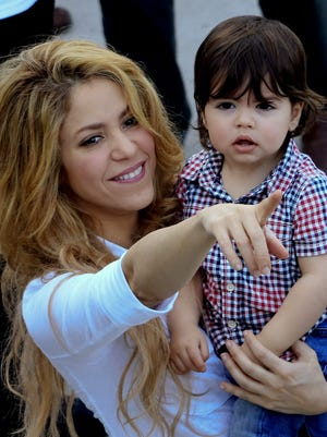 Shakira holds her son, Milan Piqué, during the inauguration of a school in Cartagena, Colombia on Feb. 24, 2014.