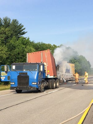 A two semi crash shutdown I-64 in Warrick County Friday morning.