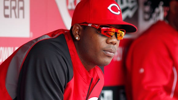 Reds relief pitcher Aroldis Chapman watches from the dugout April 13.
