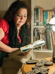 Marietta Valdez relaxes in her new home and reads a