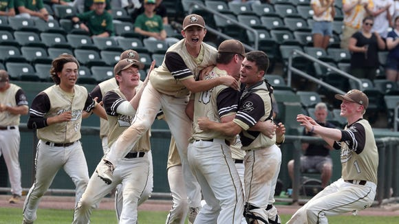 Clarkstown South pitcher Kieran Finnegan is mobbed by teammates after Clarkstown South defeated Mamaroneck 4-0 in the Section 1 Class AA baseball championship game at Palisades Credit Union Park in Pomona May 26, 2018. Finnegan pitched a one-hit complete game against Mamaroneck.