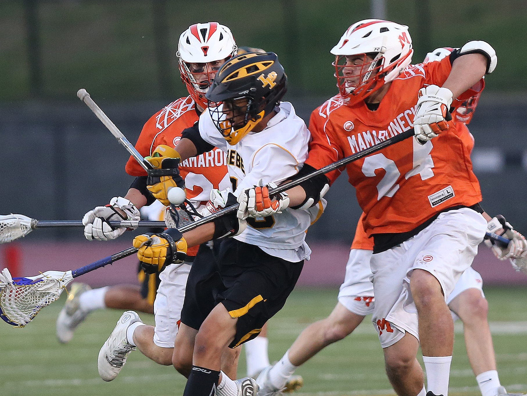 Lakeland/Panas' Brian Toy (18) has the ball knocked away by Mamaroneck's Max Plonsner (24) during the Section 1 championship game at White Plains High School May 25, 2016.