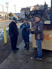Frederic Hoffman (left), owner of A & H Manufacturing, and his son John Hoffman talk with Pennsylvania State Police Fire Marshal Janssen Herb about what may have sparked the blaze that destroyed half of the Myerstown business early Wednesday morning.