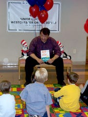 George Latimer during his years in the state Assembly, reading to children at the Mamaroneck Public Library to commemorate National Library Awareness Week.