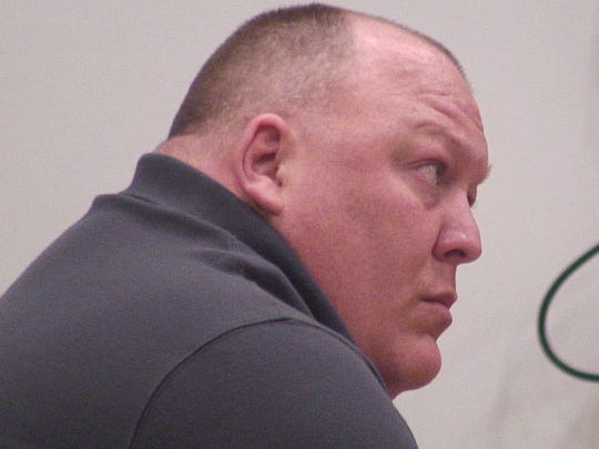 Michael Bouffard listens to court proceedings at the