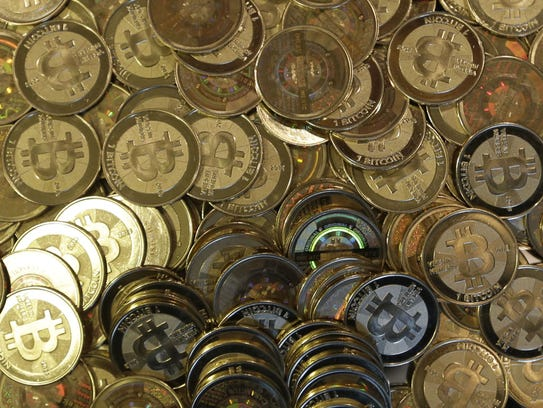 This April 3, 2013 file photo shows bitcoin tokens