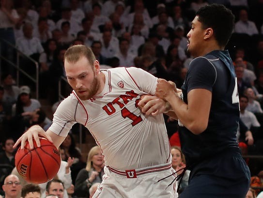 Utah forward David Collette (13) drives against Penn