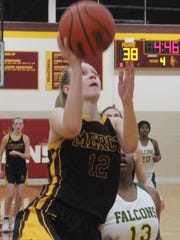 Mercy's Jenna Schluter (12) scores halfway through