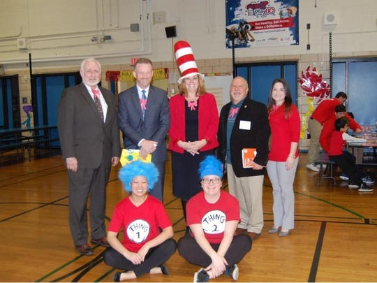 Pictured from left to right top row, Guest Readers included – Tom Mazur, Supervisor of Fine and Performing Arts;  James McLaughlin, Superintendent of Schools; Cathy Kobylarz, Principal; Michael Giordano, Mayor; Michele Armento, Supervisor of Testing.  Bottom Row – Leanne Borbely, Thing 1 and Regina Silverii, Thing 2