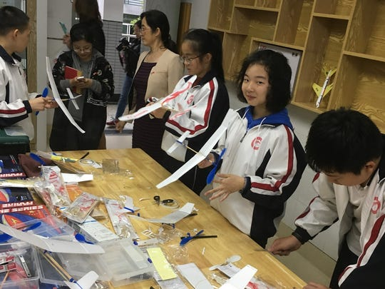 Students at a school in Hangzhou, China, work on a creative project with model planes.