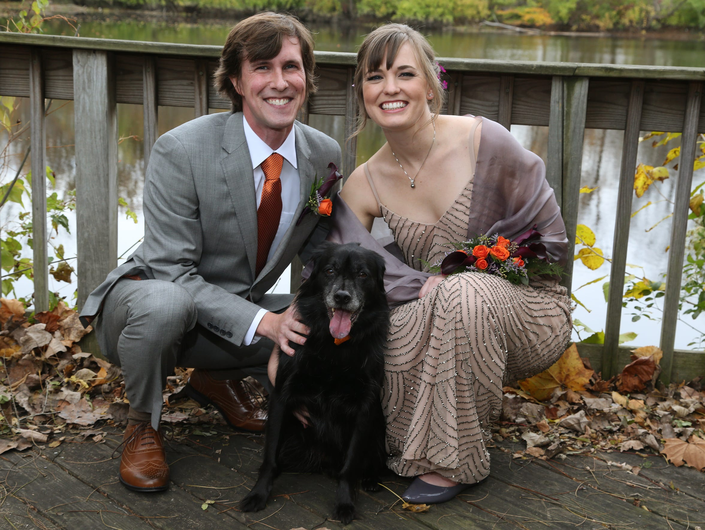 Nora Hertel and Ben Decker pose with their dog Finnigan
