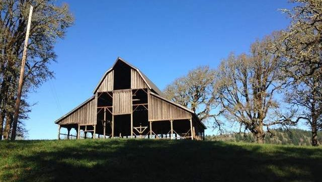 A restored barn marks the trailhead to the top of Bald Hill from the west side of the hill.