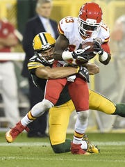 Green Bay Packers wide receiver Jeff Janis tackles De'Anthony Thomas of the Kansas City Chiefs at Lambeau Field.