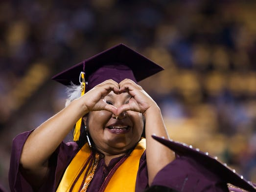Dede Gaisthea makes a heart for her daughter at ASU's 2014 spring commencement at Sun Devil Stadium on Wednesday, May 14, 2014 in Tempe, Arizona.