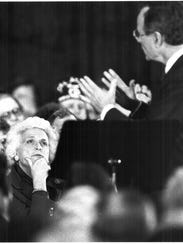 Barbara Bush listens to her husband at the Marriott
