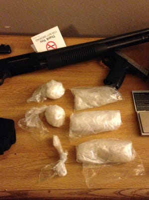 Methamphetamine and firearms were seized at an Alexandria motel. Two men were arrested.