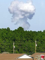 In this May 2004 photo, a plume of smoke rises over the Eglin Air Force Base reservation in Fort Walton Beach, Fla., during a test of the GBU-43B, or massive ordnance air blast (MOAB) weapon, which contains 11 tons of explosives. U.S. forces in Afghanistan struck an Islamic State tunnel complex in eastern Afghanistan on Thursday, April 13, 2017, with a GBU-43B, the largest non-nuclear weapon ever used in combat by the U.S. military, Pentagon officials said.