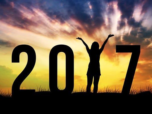 woman Enjoying and 2017 years while celebrating new year