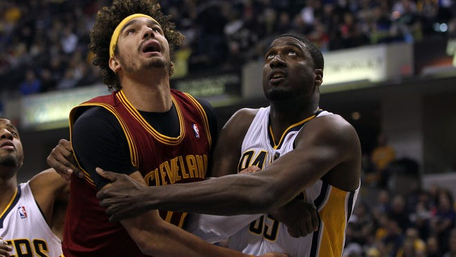 Cleveland Cavaliers center Anderson Varejao (17) and Indiana Pacers center Roy Hibbert (55) battle for position  at Bankers Life Fieldhouse.