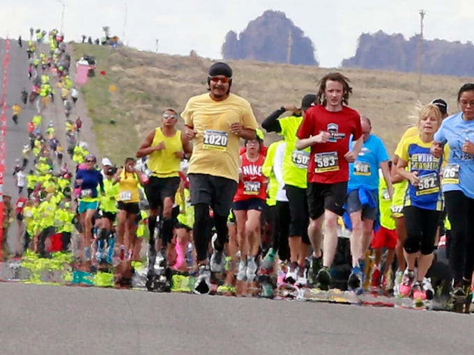 Runners in the half marathon make their way up U.S.