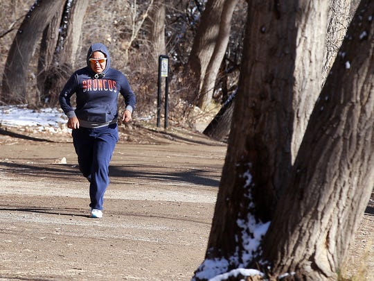 Johniell Charles jogs on a brisk Tuesday afternoon at Berg Park in Farmington.