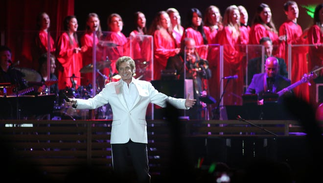 Twenty-nine members of the University of Green Bay Chorale joined Barry Manilow onstage at the Resch Center on April 21. Perhaps none was more excited than junior Heather Roberts, fourth from left, who is a big Manilow fan.