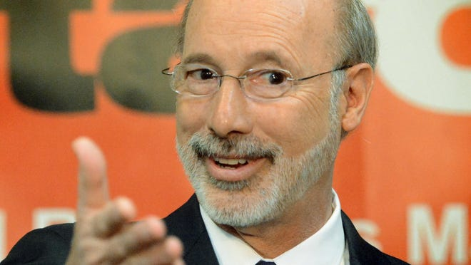 """Gov. Tom Wolf answers questions during a news conference at York College's J.D. Brown Center for Entrepreneurship Friday, April 10, 2015. Wolf toured the facility as part of his """"Jobs that Pay"""" tour. Bill Kalina - bkalina@yorkdispatch.com"""