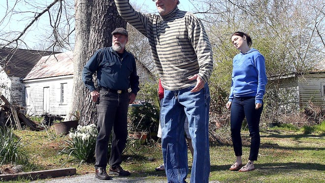 ADVANCE FOR USE FEB. 21, 2015, AND THEREAFTER- In this Feb. 10, 2015, photo, Al Guarisco, left, and Crystal Phillipesen, right, watch while Ed Hammerli tosses a petanque ball in Thibodaux, La. The goal of petanque, which is most popular in southern France, is to throw hollow metal balls as close as possible to the cochonnet, a small wooden ball, while standing inside a circle with both feet on the ground. (AP Photo/The Daily Comet, Abby Tabor)