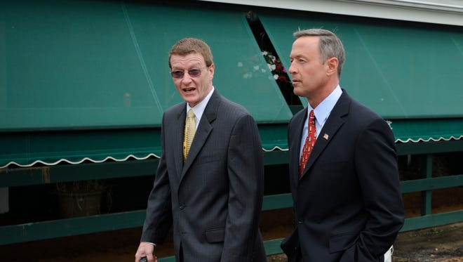 Maryland Governor Martin O'Malley, right, walks with Tom Chuckas, President of the Maryland Jockey Club next to the Stakes Barn at Pimlico Race Course before the 134th running of the Preakness Stakes horse race on Saturday, May 16, 2009, in Baltimore. (AP Photo/Nick Wass)