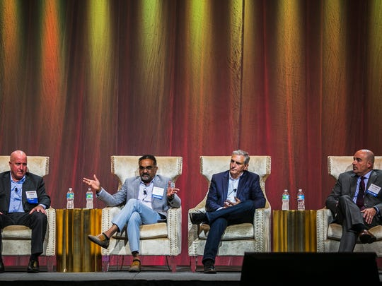 "From left, Chad Crandell, managing director and CEO of CHMWarnick; Bharat Patel, chairman and CEO of Sun Development and Management Corp.; Butch Spyridon, president and CEO of the Nashville Convention & Visitors Corp.; and Peter Phillippi, managing director, head of hospitality group at Piper Jaffray and Co., sit on a panel discussion called ""Convention Center Hotel Impact on the Market — Does It Lift All Boats or Drain the Swamp?"" during the Southern Lodging Summit on Aug. 30, 2017, at the Memphis Cook Convention Center."