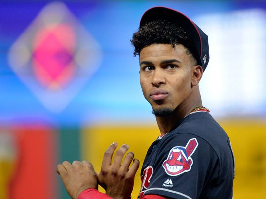 FILE - In this Oct. 11, 2017, file photo, Cleveland Indians' Francisco Lindor warms up before an American League Division Series playoff game against the New York Yankees in Cleveland. Determined to end their World Series title drought in 2017 after coming so close the previous season, the AL Central champions were bounced in the playoffs by the New York Yankees despite taking a 2-0 series lead. It was a bitter finish for a team that won 102 games and reeled off 22 straight victories. But while there was a sense of finality for some Cleveland fans, manager Terry Francona said these Indians aren't done. (AP Photo/Phil Long, File)
