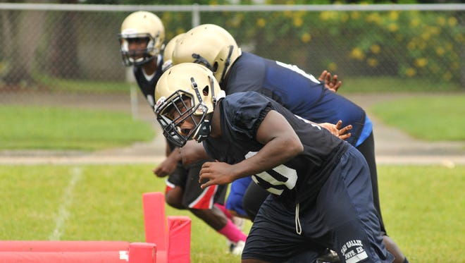 Tuesday afternoon football practice for the Eau Gallie Commodores football team.